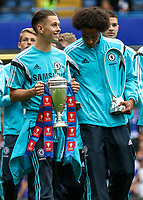 Football - 2014 / 2015 Premier League - Chelsea vs. Sunderland.   <br /> <br /> Chelsea's Academy players take a lap of honour and show the FA Youth trophy won at Stamford Bridge. <br /> <br /> COLORSPORT/DANIEL BEARHAM