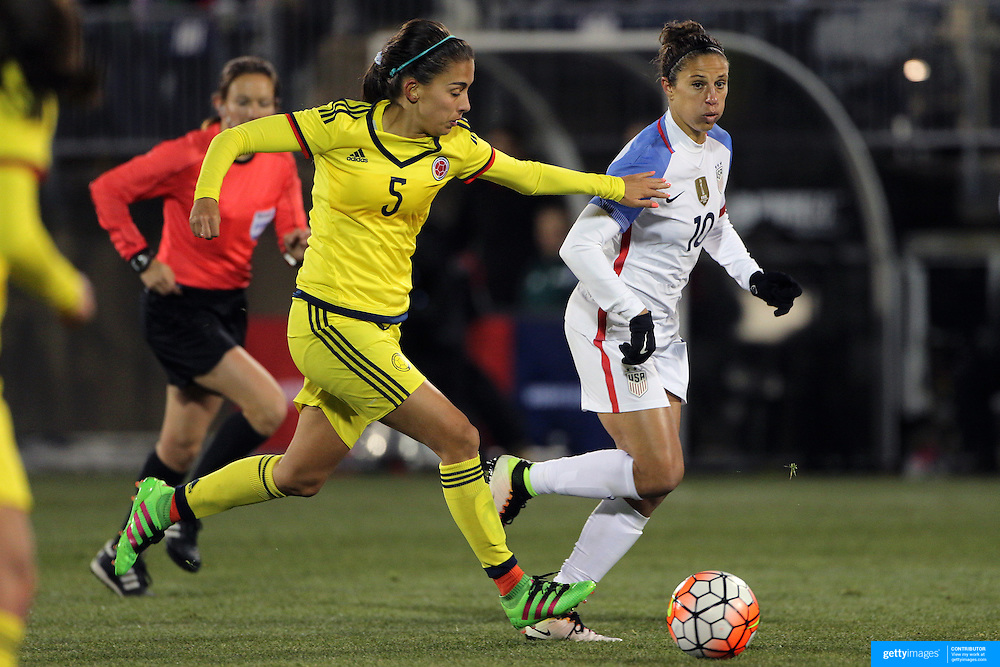 Carli Lloyd, (right), USA, is challenged by Isabella Echeverri, Colombia, during the USA Vs Colombia, Women's International friendly football match at the Pratt & Whitney Stadium, East Hartford, Connecticut, USA. 6th April 2016. Photo Tim Clayton