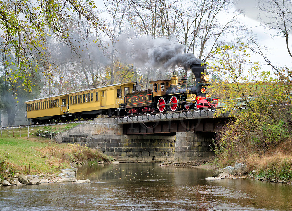 This train is a built-from-scratch replica of the one that carried Lincoln&rsquo;s casket to Springfield, Illinois, for burial in 1865, and the route of that train was on these very rails just south of York, Pennsylvania. It is located in New Freedom, PA and runs ten miles of re-railed Northern Central Railroad track that the original funeral train ran upon. This was accomplished with York County Parks working with the locomotive builder, and together they've created something very unique that you can visit and ride through some very scenic landscape. Here, the locomotive and two cars cross the South Branch of Codorus Creek in the Pennsylvania farm land on the way back to New Freedom.<br /> <br /> Occasionally the engine is borrowed by Hollywood for period movie making. It is trucked to where it's needed, given cosmetic changes to suit and then filmed, and afterward the locomotive is brought back to this 1865 appearance and returned to New Freedom. Historical Civil War weekend encampments are done nearby and reenactors sometimes accompany the railroad operations, when it becomes a true time machine. The main freight this train carries these days is the imagination of hundreds.<br /> <br /> This piece of living history is almost a one of a kind accomplishment and worth visiting if you enjoy history and live steam railroading. If you would like to learn more and see an operating schedule, visit the website www.steamintohistory.com<br /> <br /> Monthly Newsletter sign up at Dierks Photo on Facebook...
