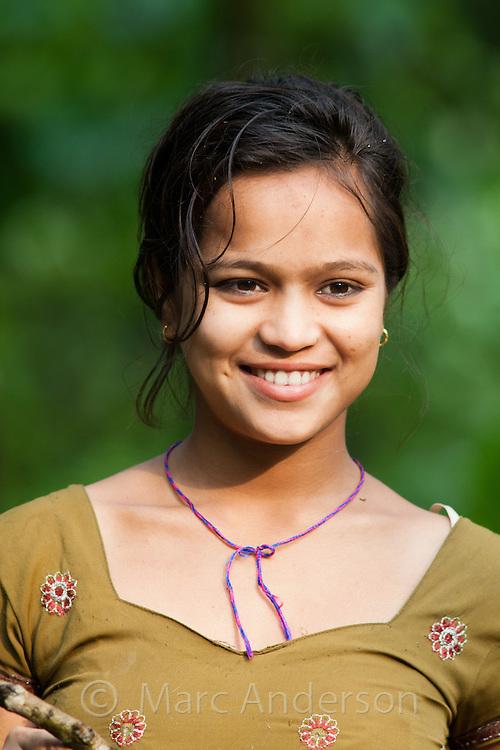 Portrait of a Tharu girl smiling, Terai region, Nepal