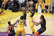 Los Angeles Sparks guard Alexis Jones (1) jumps to shoot as Connecticut Sun guard Jasmine Thomas (5) defends during a WNBA basketball game, Friday, May 31, 2019, in Los Angeles.The Sparks defeated the Sun 77-70.  (Dylan Stewart/Image of Sport)