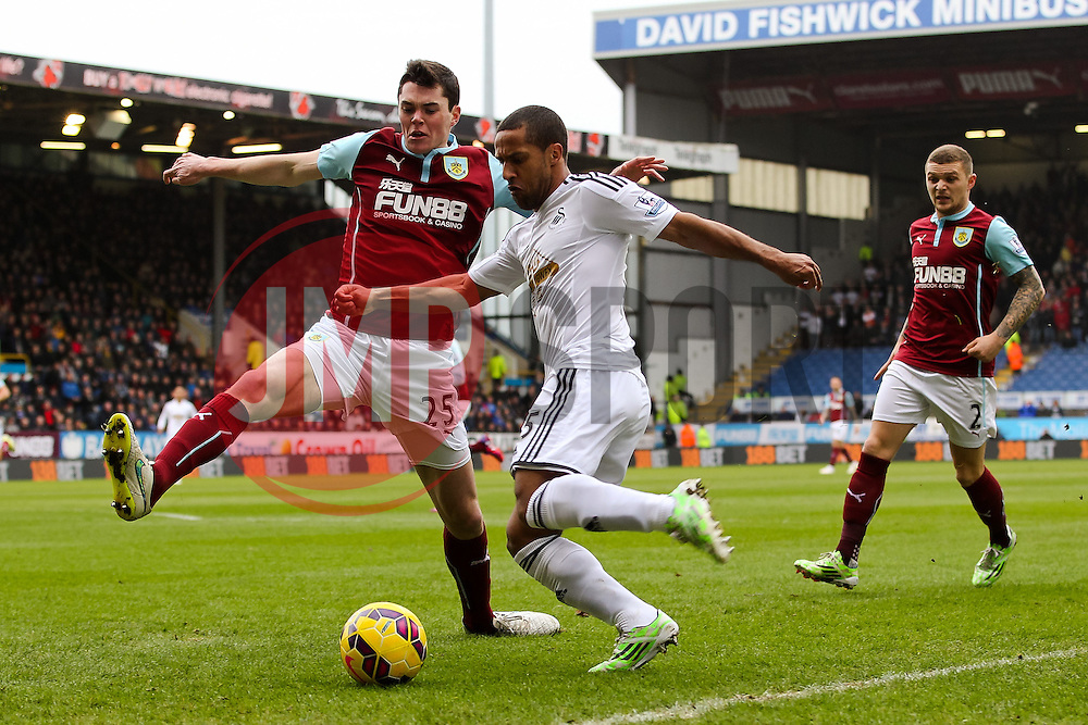 Wayne Routledge of Swansea City has a cross blocked by Burnley's Michael Keane  - Photo mandatory by-line: Matt McNulty/JMP - Mobile: 07966 386802 - 28/02/2015 - SPORT - Football - Burnley - Turf Moor - Burnley v Swansea City - Barclays Premier League