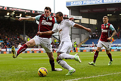 Wayne Routledge of Swansea City has a cross blocked by Burnley's Michael Keane  - Photo mandatory by-line: Matt McNulty/JMP - Mobile: 07966 386802 - 28/02/2015 - SPORT - Football - Burnley - Turf Moor - Burnley v Swansea City - Barclays Premier League
