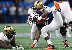Auburn Tigers running back Kerryon Johnson (21) is tackled by UCF Knights linebacker Chequan Burkett (2) during the Chick-fil-A Peach Bowl NCAA college football game January 1, 2018, in Atlanta. (David Tulis via Abell Images for Chick-fil-A Peach Bowl)