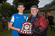 Grenville Dawson secretary of the Dundee Schools Football Association presents the Senior Johnston Trophy final man of the match award to St John's Ross Graham - Grove (light blue v St John's (blue) Senior Johnston Trophy Final at Whitton Park, Dundee, Photo: David Young<br /> <br />  - &copy; David Young - www.davidyoungphoto.co.uk - email: davidyoungphoto@gmail.com