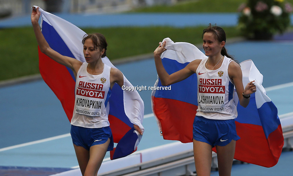 13.08.2013. Moscow, Russia.  IAAF World Cup 2013 Moscow Russia. Lashmanova, Elena r of Russia Celebrates with teammate  Anisya Kirdyapkina after the womens 20 Kilometers Race Walk Final in Day 4 of The 14th IAAF World Athletics Championships claimed The Title with 1 27 08 Anisya Kirdyapkina took The Silver
