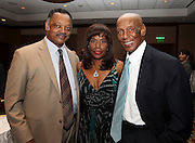 ATLANTA, GA - MAY 14:  Hall of Famer and Beacon Award recipient Ernie Banks (right) and his wife Liz meet Reverend Jesse Jackson at the MLB Beacon Awards Banquet at the Omni Hotel on May 14, 2011 in Atlanta, Georgia.  (Photo by Mike Zarrilli/Getty Images)