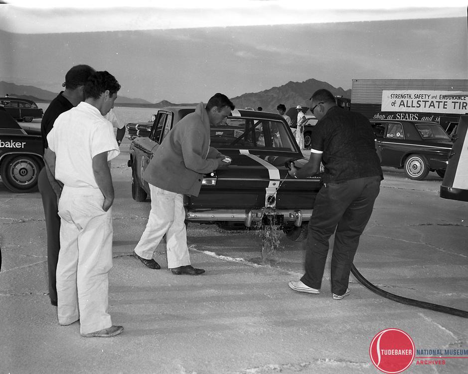 Refueling the #6 Studebaker Commander at the Bonneville Salt Flats, October 1963.