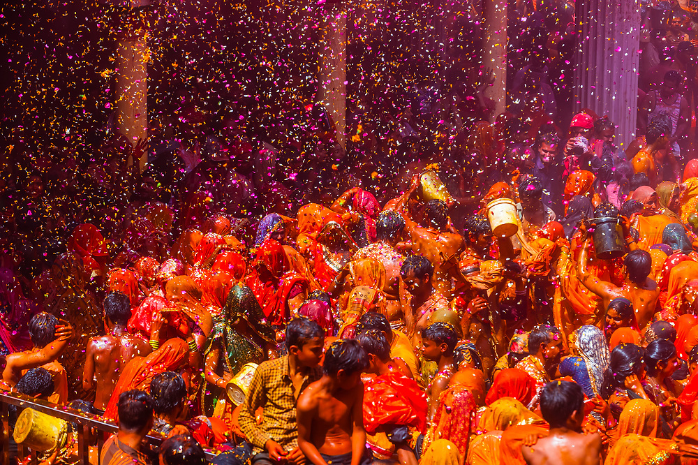 'Huranga' is a game played between men and women a day after Holi, the festival of colours, during which men drench women with liquid colours and women tear off the clothes of the men; Holi Festival, Dauji Temple, Badeo (near Mathura), Uttar Pradesh, India.