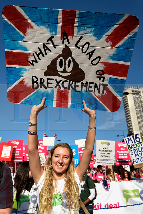 © Licensed to London News Pictures. 20/10/2018. LONDON, UK. A woman carries a placard.  Thousands of people take part in a demonstration, organised by the People's Vote campaign, beginning with a march from Park Lane to a rally in Parliament Square.  The People's Vote seeks a referendum on the outcome of the final Brexit negotiations ahead of 29 March 2019, the date that the UK is due to leave the EU.  Photo credit: Stephen Chung/LNP
