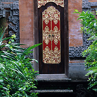 Bali, Ubud, palace grounds, ornate carved door