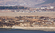 A North Korean village and military facilities in Kaepung county, North Hwanghae province, are seen in this picture taken from Ganghwa Peace Observatory of South Korea, about 2 km (1.2 miles) south of the North Korean territory, in Ganghwa, 56 km (35 miles) northwest of Seoul, South Korea, Dec 4, 2017. Photo by Lee Jae-Won (KOREA) www.leejaewonpix.com