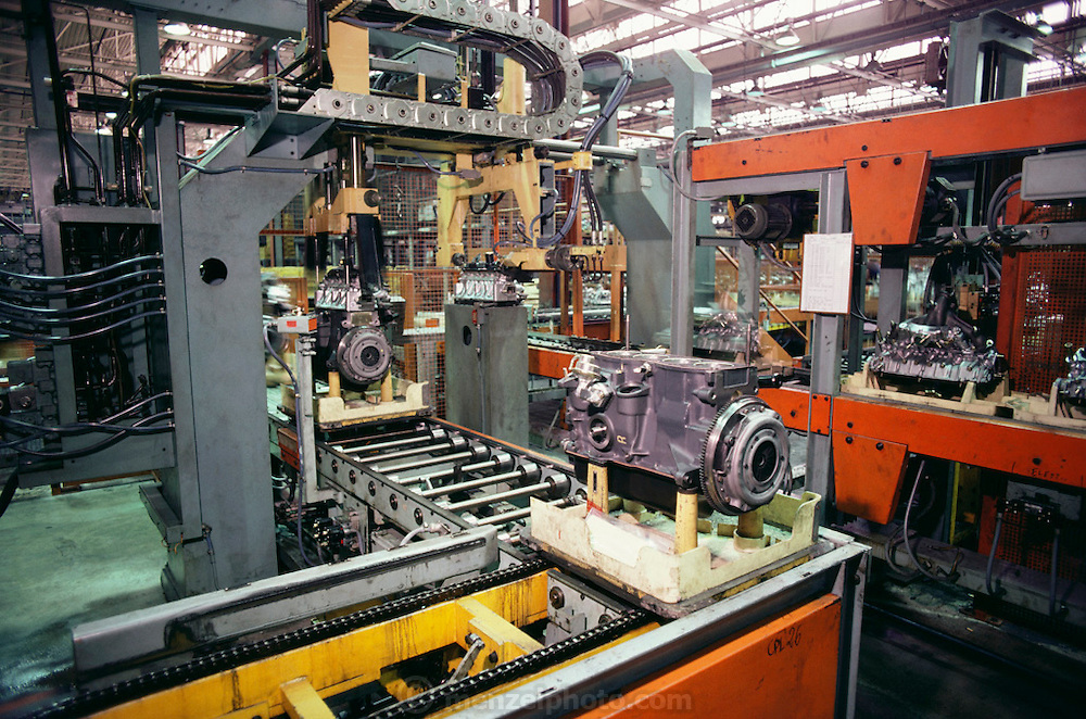 Fiat car engine factory, Turin, Italy. In the 1980's Fiat used automated carriers guided by wires in the floor as well as more traditional conveyors (seen here) to move engines from one assembly station to another: LAM.
