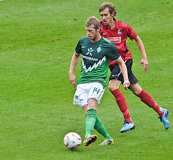23.07.2010, Stadion Friedengrund, Villingen, GER,   Werder Bremen vs SC Freiburg T Friendly Match  1. FBL 2010  im Bild Aaron Hunt ( Werder #14 ) gegen Julian Schuster ( Freiburg #23 )    EXPA Pictures © 2010, PhotoCredit: EXPA/ nph/  Kokenge+++++ ATTENTION - OUT OF GER +++++ / SPORTIDA PHOTO AGENCY