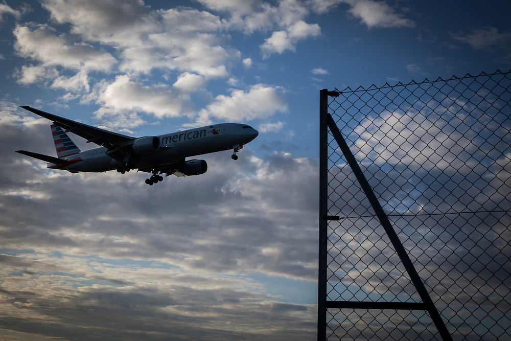 An American Airlines Boeing 777 landing at Heathrow airports north runway behind the boundary security fence.  Heathrow Airport, London. (photo by Andrew Aitchison / In pictures via Getty Images)