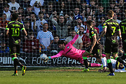 Forest Green Rovers goalkeeper James Montgomery makes a save from Tranmere Rovers Paul Mullin(9) during the EFL Sky Bet League 2 match between Tranmere Rovers and Forest Green Rovers at Prenton Park, Birkenhead, England on 19 April 2019.
