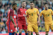 Bailey Wright (Australia) is marked by Jordan Henderson (England) as they wait for a corner to come in during the Friendly International match match between England and Australia at the Stadium Of Light, Sunderland, England on 27 May 2016. Photo by Mark P Doherty.