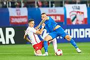 Lublin, Poland - 2017 June 16: (L) Jan Bednarek from Poland U21 fights for the ball with (R) Adam Zrelak from Slovakia U21 while Poland v Slovakia match during 2017 UEFA European Under-21 Championship at Lublin Arena on June 16, 2017 in Lublin, Poland.<br /> <br /> Mandatory credit:<br /> Photo by &copy; Adam Nurkiewicz / Mediasport<br /> <br /> Adam Nurkiewicz declares that he has no rights to the image of people at the photographs of his authorship.<br /> <br /> Picture also available in RAW (NEF) or TIFF format on special request.<br /> <br /> Any editorial, commercial or promotional use requires written permission from the author of image.