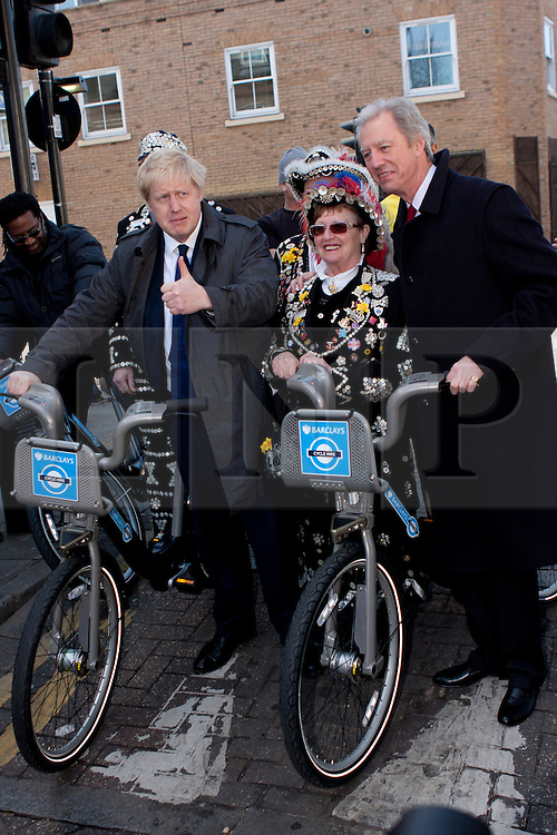 © Licensed to London News Pictures. 08/03/2012. London, UK. Mayor of London Boris Johnson (left) with Marcus Aigus (Right, Chairman of Barclays) pictured with two Pearly Queens at the Roman Road Market in Bow today (08/03) to publicise the eastern extension of the Barclays Bike cycle hire scheme which launches today. Photo credit : James Gourley/LNP