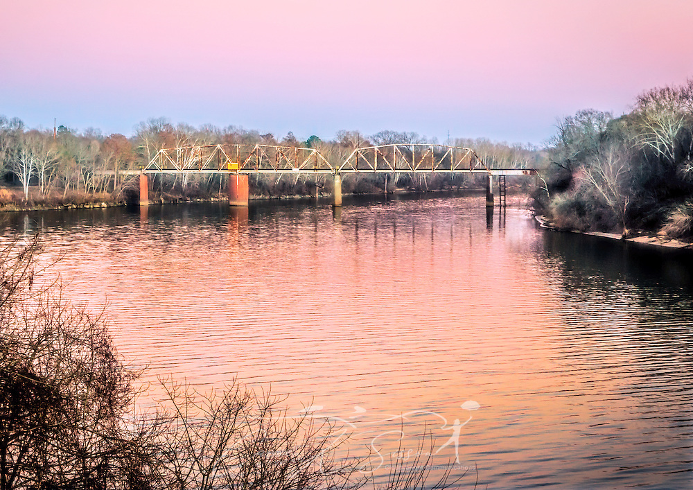 The sun sets on the CSX railroad bridge over the Alabama River, Feb. 14, 2015, in Selma, Alabama. The bridge is a Parker through truss swing bridge. (Photo by Carmen K. Sisson/Cloudybright)