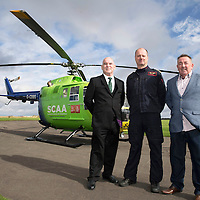 National Air Ambulance Week.. Britain's last Bolkow helicopter air ambulance operated by SCAA prepares to fly into history when it is replaced by EC-135 in November 2015. To mark this Scotland's original Bolkow paramedics gathered at Perth Airport to meet the current crew.<br /> Pictured are Gerry Kelly and Ian Golding who served as Paramedics on the Bolkow when first introduced to Scotland in 1989, with current Captain Russell Myles Senior Pilot<br /> Picture by Graeme Hart.<br /> Copyright Perthshire Picture Agency<br /> Tel: 01738 623350  Mobile: 07990 594431