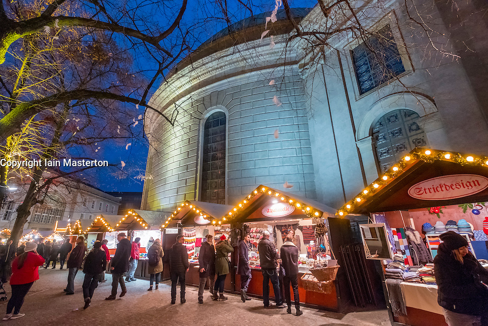 Night view of traditional Christmas Market at St Hedwig's Cathedral at night in Mitte Berlin Germany 2016