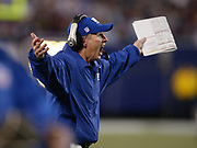 Giants' Head Coach, Tom Coughlin reacts to a referee's call during an NFL football game against the Chicago Bears on Sunday, November 7, 2004 in New Jersey. Photo by Kathy Kmonicek