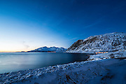 Simply beautiful evening light over the bay and snow covered mountains. (Photo by Travel Photographer Matt Considine)
