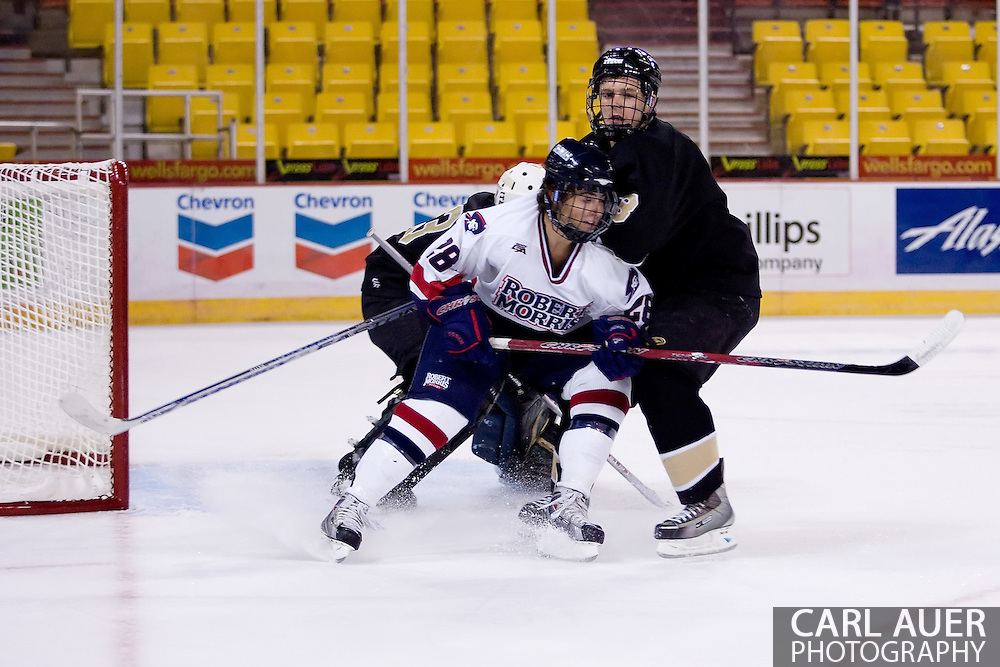 October 13, 2007 - Anchorage, Alaska: Scott Kobialko (28) of the Robert Morris Colonials sets up in front of the Warrior goal as the Colonials take a 4-1 victory over the Wayne State Warriors at the Nye Frontier Classic at the Sullivan Arena.