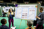 Haley Heusey and Lydia Richardson present their findings to a panel of judges. They exposed hairless mice to ultra violet radiation in attempt to learn more about how to prevent and cure skin cancers caused by UVB rays.