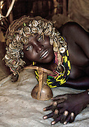 Ethiopian Tribe Recycles Modern Worldís Discards Into Fashion Accessories<br /> <br /> The Daasanach are a semi-nomadic tribe numbering approximately 50,000 individuals who live in the Omo Valley in southern Ethiopia. In the past, the tribe roamed from place to place herding livestock around open areas according to the seasons and the changing availability of water. But over the last fifty years, having lost the majority of their lands, they have also grown dependent to agriculture. Like many tribes in the region, the Daasanach have moved to areas closer to the Omo River, where they attempt to grow enough crops to survive.<br /> <br /> French photographer Eric Lafforgue has spent several years documenting the life and culture of these people, and how they have changed under the influence of modern manufactured goods. An interesting fashion trend amongst the Dassanach is their elaborate headgear, which they make from the strangest of materials  bottle caps, wristwatches, hairclips, and other discarded pieces of plastic and metal.<br /> The Daasanach spend months collecting bottle caps and scratching around for cash to pay for broken watches, which the women makes into jewelry and wigs. These are worn by both men and women, young and old.<br /> <br /> Younger girls and children get the most basic version of the wig, while the oldest women are treated to the heaviest numbers with the most embellishment.<br /> Men are only allowed to wear the bottle top wigs until they marry - after that, they create small clay headpieces decorated with a colourful harlequin pattern and enlivened with a feather, although the latter is only allowed after a hunt or a successful clash with an enemy.<br /> <br /> The young men love to wear necklaces and earrings while the girls have bigger muscles because they do the most difficult work like carrying water, To prevent their headgears from getting spoiled while they sleep (apparently, they never take them off).<br /> ©Eric lafforgue/Exclusiv