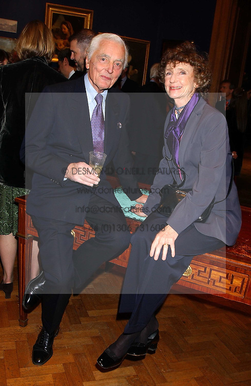 The EARL OF AIRLIE and LINDY, MARCHIONESS OF DUFFERIN & AVA at a reception hosted by Brian Ivory Chairman of the Trustees of The National Galleries of Scotland to commemorate Sir Timothy Clifford's 21 years of Director of the National Gallery of Scotland and his forthcoming retirement in January 2006, held at Christie's, King Street, London W1 on 6th December 2005.<br />
