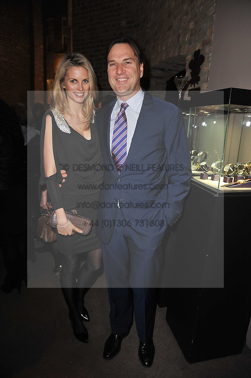 JONATHAN & FRIDA LOURIE at a party to celebrate the launch of Simon Sebag-Montefiore's new book - 'Jerusalem: The Biography' held at Asprey, 167 New Bond Street, London on 26th January 2011.
