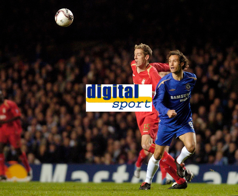 Photo: Leigh Quinnell.<br /> Chelsea v Liverpool. UEFA Champions League. <br /> 06/12/2005. Chelseas Ricardo Carvalho and Liverpools Peter Crouch clash for the ball.