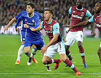 Football - 2016 / 2017 League [EFL] Cup - Fourth Round: West Ham United vs. Chelsea<br /> <br /> Aaron Cresswell of West ham and Oscar of Chelsea at the London Stadium.<br /> <br /> COLORSPORT/ANDREW COWIE