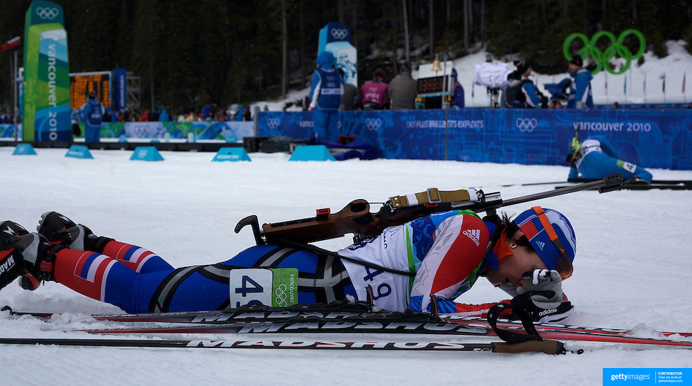 Winter Olympics, Vancouver, 2010.Olga Medvedtseva, Russia, (nearest camera) feels the pain after finishing during the Women's 7.5 KM Sprint Biathlon at The Whistler Olympic Park, Whistler, during the Vancouver  Winter Olympics. 13th February 2010. Photo Tim Clayton