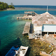 Unloading supplies from a barge in Jewel Cay, Utila, Honduras.  May 2009. (Photo/William Byrne Drumm)