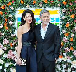 George Clooney and his wife Amal, representing the Clooney Foundation for Justice, arrive to collect an award for their charity work at the People's Postcode Lottery Charity Gala in Edinburgh <br /> <br /> Pictured: George Clooney and wife Amal<br /> <br /> (c) Aimee Todd | Edinburgh Elite media