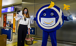 """Workers say a """"Hello"""" with a smile and face mask as a gift  to the passengers that come to the Eleftherios Venizelos International Airport in Athens, Monday, June 15, 2020. Greece is officially open to tourists as of Monday, with the first international flights expected into Athens and the northern city of Thessaloniki where passengers will not face compulsory COVID-19 tests. Seasonal hotels and museums are also opening across the country. <br /> <br /> Pictured: <br /> Dimitris Lampropoulos  