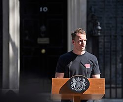 © Licensed to London News Pictures. 24/05/2019. London, UK. A sound engineer, being referred to as 'Podium Guy, tests a microphone while stood at the podium, before a resignation speech by British Prime Minister Theresa May, on Downing Street. The Prime Minister was under huge pressure to quit over her handing of negotiations for the UK's exit from the European Union. Photo credit: Ben Cawthra/LNP