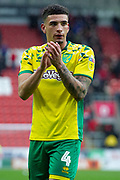 Norwich City midfielder Ben Godfrey (4) gestures at full time towards the Norwich City fans as they beat Rotherham United 1-2 during the EFL Sky Bet Championship match between Rotherham United and Norwich City at the AESSEAL New York Stadium, Rotherham, England on 16 March 2019.