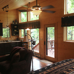 Almont, CO, Cabin Remodel, 2012-2013<br /> Located just a stone&rsquo;s throw from the East River in Almont, Colorado, this small guest cabin was extensively remodeled, on both the exterior and interior, to house the Reid family&rsquo;s frequent guests.  A revised entry and wide wood deck enhance the connection to the adjacent river.  New windows fill the interior with natural light.  The addition of a kitchenette allows guests to be self-sufficient during their stay.<br />  Beckwith Builders, Inc. was the general contractor for the construction of this house.