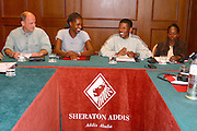 ADDIS ABABA, ETHIOPIA..Sheraton Addis Hotel. German travel expert Paul Friedrich (l.) of Afrika Reisen Exklusiv and high jumper Amewu Mensah (2nd from l.) with the Olympic Winner over 10.000 m, Haile Gebre Selassie (3rd from l.), runner Gete Wami (r.).(Photo by Heimo Aga)