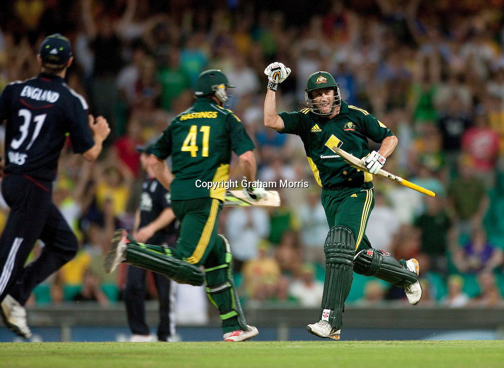 David Hussey (right) celebrates winning the third one day international between Australia and England at the SCG in Sydney, Australia. Photo: Graham Morris (Tel: +44(0)20 8969 4192 Email: sales@cricketpix.com) 23/01/11