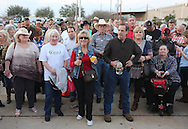 People stand outside as they wait for  Republican presidential candidate Ted Cruz to speak to supporters at his election night party after Super Tuesday in Stafford, Texas, USA, 01 March 2016. Twelve states voted in the early primary on Super Tuesday across the country.