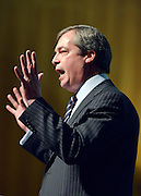 © Licensed to London News Pictures. 23/03/2013. Exeter, UK. Nigel Farage, Leader of UKIP, makes his keynote speech to the conference.  The UK Independence Party (UKIP) 2013 Spring Conference is held at the Great Hall, Exeter University today, Saturday 23rd March 2013. Support for the party is rising after success in the recent Eastleigh by-election, where UKIP came second behind the Liberal Democrats. Photo credit : Stephen Simpson/LNP
