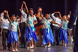 "Ull Muller students warm up by dancing the Meringue.  Dancing Classrooms Virgin Islands students compete in ""Colors of the Rainbow"" team match competition at Reichhold Center for the Arts.  St. Thomas, USVI.  9 May 2015.  © Aisha-Zakiya Boyd"