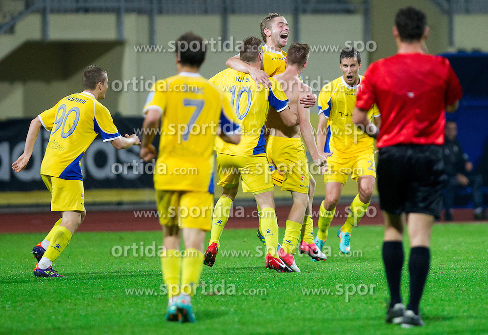 Players of Domzale celebrate after 2nd goal during football match between NK Domzale and ND Triglav in 14th Round of Slovenian First League PrvaLiga NZS 2012/31 on October 20, 2012 in Sports centre, Domzale, Slovenia. (Photo By Vid Ponikvar / Sportida)