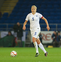 CARDIFF, WALES - Tuesday, August 21, 2014: England's captain Steph Houghton in action against Wales during the FIFA Women's World Cup Canada 2015 Qualifying Group 6 match at the Cardiff City Stadium. (Pic by Ian Cook/Propaganda)