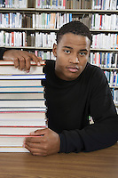 Student with a Stack of Books in the Library